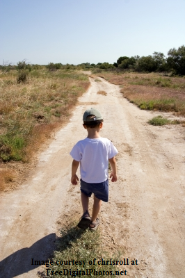 Boy Walking down road